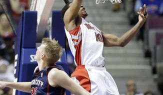 Toronto Raptors guard DeMar DeRozan (10) dunks while defended by Detroit Pistons forward Kyle Singler (25) during the first half of an NBA basketball game in Auburn Hills, Mich., Sunday, April 13, 2014. (AP Photo/Carlos Osorio)