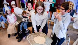 Children see fresh matzah bread they helped make as it comes out of the oven as they learn how to make matzah bread at the Congregation Har Tzeon-Agudath Achim, Silver Spring, Md., Wednesday, April 9, 2014. (Andrew Harnik/The Washington Times)