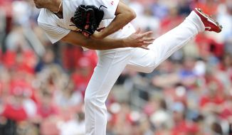 St. Louis Cardinals' starting pitcher Michael Wacha throws against the Chicago Cubs in the first inning of a baseball game, Sunday, April 13, 2014, in St. Louis. (AP Photo/Bill Boyce)