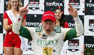 Mike Conway, of England, celebrates his win in the IndyCar Grand Prix of Long Beach auto race, Sunday, April 13, 2014, in Long Beach, Calif. (AP Photo/Alex Gallardo)