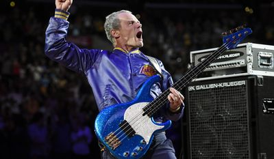 Flea, bassist for the Red Hot Chili Peppers, plays the national anthem prior to an NBA basketball game between the Los Angeles Lakers and the Memphis Grizzlies, Sunday, April 13, 2014, in Los Angeles.  (AP Photo/Mark J. Terrill)