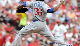Chicago Cubs' starting pitcher Edwin Jackson throws against the St. Louis Cardinals in the first inning of a baseball game, Sunday, April 13, 2014, in St. Louis. (AP Photo/Bill Boyce)