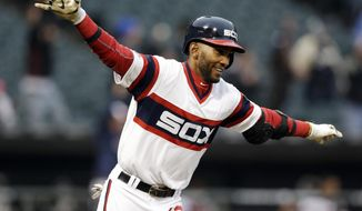 Chicago White Sox's Alexei Ramirez celebrates as he rounds the bases after hitting the game-winning two-run home run during the ninth inning of a baseball game against the Cleveland Indians in Chicago on Sunday, April 13, 2014. The White Sox won 4-3. (AP Photo/Nam Y. Huh)