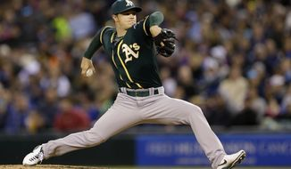 Oakland Athletics starting pitcher Sonny Gray throws against the Seattle Mariners in the sixth inning of a baseball game, Saturday, April 12, 2014, in Seattle. (AP Photo/Ted S. Warren)