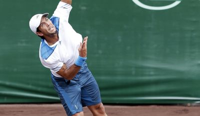 Fernando Verdasco, of Spain, serves to Nicolas Almagro, of Spain, in the first set of their final match at the U.S. Men's Clay Court Championship tennis tournament Sunday, April 13, 2014, in Houston. (AP Photo/Pat Sullivan)