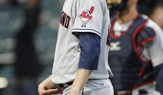 Cleveland Indians closer John Axford reacts as he leaves the field after Chicago White Sox's Alexei Ramirez hit the game-winning two-run home run during the ninth inning of a baseball game in Chicago on Sunday, April 13, 2014. The White Sox won 4-3. (AP Photo/Nam Y. Huh)