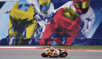 Marc Marquez, of Spain, makes turn 20 during the MotoGP Grand Prix of the Americas motorcycle race at the Circuit of the Americas, Sunday, April 13, 2014, in Austin, Texas. (AP Photo/Eric Gay)