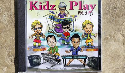 "ADVANCE FOR SUNDAY, APRIL 13 - This photo taken on April 3, 2014, in Roanoke, Va., shows the CD ""Kidz Play,"" released by Emily Guill, of Roanoke, Va., Rudy Banks of Christiansburg, Va. and Jonathan Holmes of Christiansburg, Va. (AP Photo/The Roanoke Times, Rebecca Barnett)"