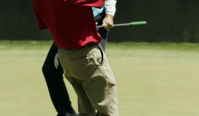 Larry Mize pumps his fist after a birdie on the ninth hole during the par three competition at the Masters golf tournament Wednesday, April 9, 2014, in Augusta, Ga. (AP Photo/Chris Carlson)