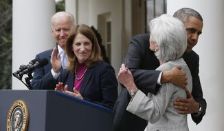President Obama hugs outgoing Health and Human Services Secretary Kathleen Sebelius as designated successor, budget director Sylvia Mathews Burwell, and Vice President Biden look on. (AP Photo/Charles Dharapak)