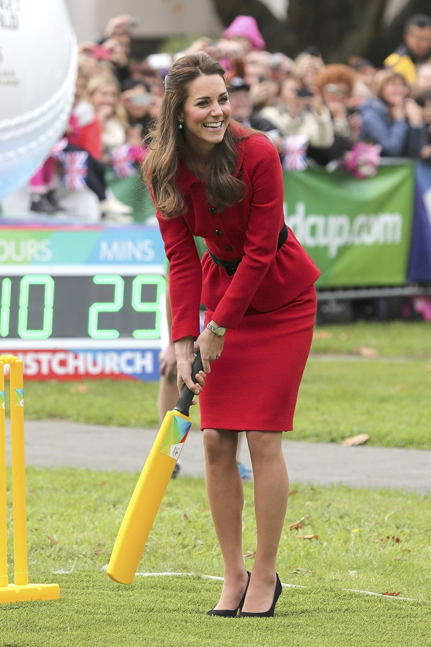 Britain's Kate, the Duchess of Cambridge, plays cricket in Latimer Square in Christchurch, New Zealand, Monday, April 14, 2014. Prince William and his wife Kate are on a three-week tour of New Zealand and Australia with their son, Prince George. (AP Photo/Martin Hunter, Pool)