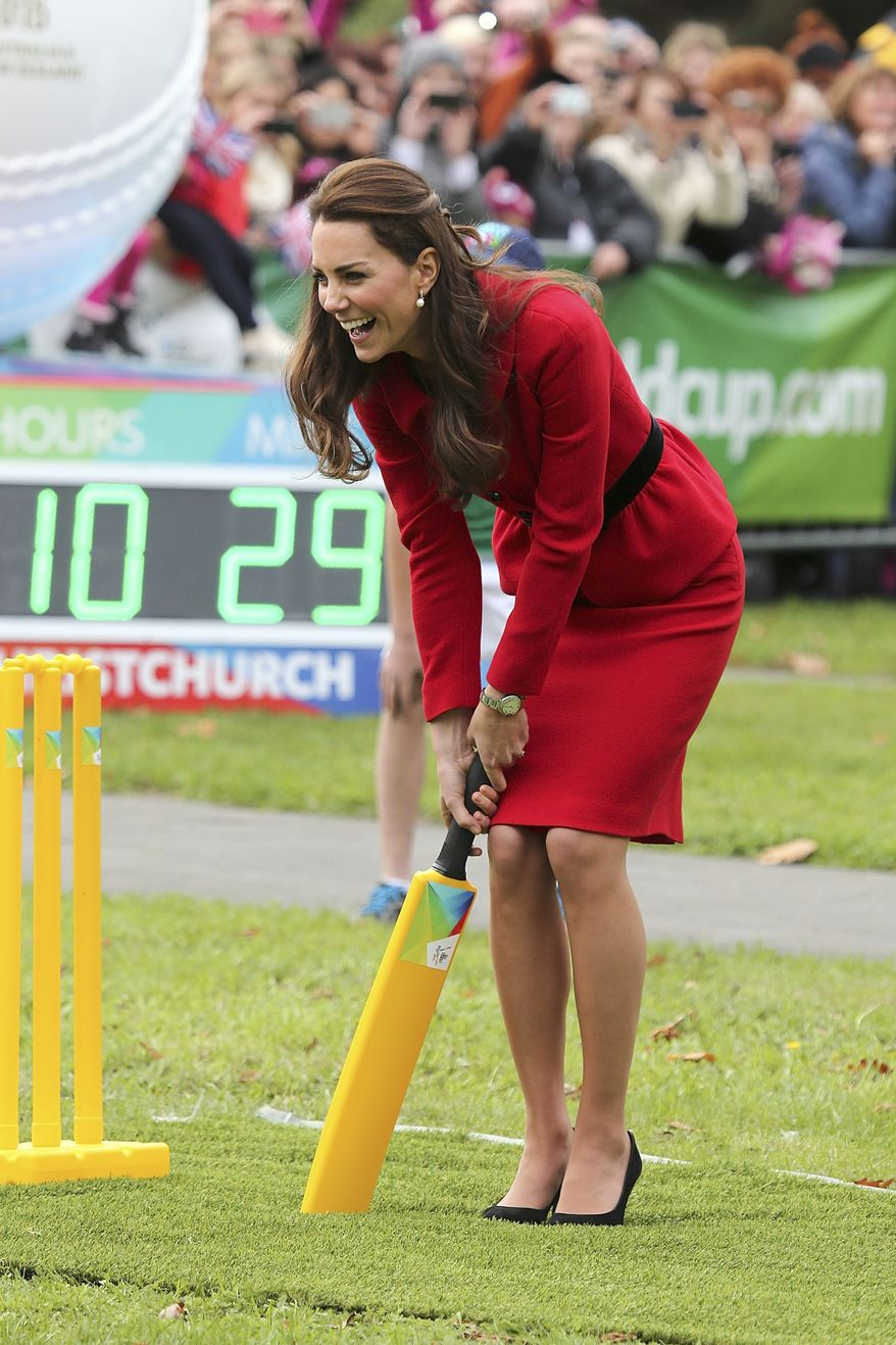 Britain's Kate, the Duchess of Cambridge, laughs while playing cricket in Latimer Square in Christchurch, New Zealand, Monday, April 14, 2014. Prince William and his wife Kate are on a three-week tour of New Zealand and Australia with their son, Prince George. (AP Photo/Martin Hunter, Pool)