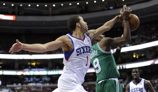 Philadelphia 76ers' Michael Carter-Williams (1) blocks a shots from Boston Celtics' Rajon Rondo during the second half of an NBA basketball game on Monday, April 14, 2014, in Philadelphia. The 76ers won 113-108. (AP Photo/Michael Perez)