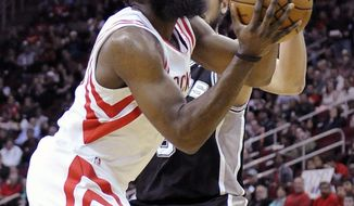 Houston Rockets' James Harden, left, pushes past San Antonio Spurs' Marco Belinelli in the first half of an NBA basketball game Monday, April 14, 2014, in Houston. (AP Photo/Pat Sullivan)