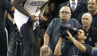 Sacramento Kings center DeMarcus Cousins reacts after being called for a technical foul against the Minnesota Timberwolves during the second half of an NBA basketball game in Sacramento, Calif., on Sunday, April 13, 2014. The Kings won 106-103.(AP Photo/Steve Yeater)