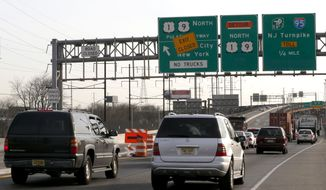 Vehicles ride near the blocked off entrance to the northbound side of the Pulaski Skyway, Monday, April 14, 2014, in Newark, N.J. The northbound side of the Skyway was closed on Saturday, April 12, 2014, and will remain closed for two years while $1 billion in repairs are done to the aging bridge. An estimated 40,000 motorists who take the Skyway toward Jersey City and The Holland Tunnel every day are being urged to carpool, take the Turnpike extension or other alternate routes or use public transportation. (AP Photo/Julio Cortez)