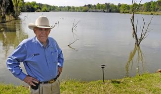 """Ray Scott, founder of the Bass Anglers Sportsman Society, stands on his property in Hope Hull, Ala., on Tuesday, April 8, 2014. The outdoor maven made his name with fishing tournaments, publications and television shows. But that wasn't why a group from New York traveled to his Pintlala property last week. Four years ago, Scott stumbled across an article in Outdoor Life that listed his Presidents Lake near Montgomery as one of the top five fishing spots in the nation. """"I thought, 'My gosh, that's incredible,'"""" he said. """"I could use that as promotional material."""" Now his Trophy Bass Retreat is """"booked pretty much solid, wall-to-wall"""" with groups paying nearly $2,000 for two days of fishing and three nights on the property.  (AP Photo/Montgomery Advertiser, Amanda Sowards)"""