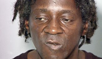 FILE- This Oct. 17, 2012 file image released by the Las Vegas Police Department shows rapper Flavor Flav, also known as William Jonathan Drayton, Jr., in a police booking photo. A prosecutor and defense attorneys say the 55-year-old former rap music and reality TV star is scheduled to enter a plea Monday, April 14, 2014 in Clark County District Court  in a plea deal that would avoid trial in a Las Vegas domestic violence case. (AP Photo/Las Vegas Police Department, file)