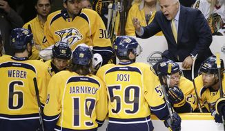 Nashville Predators coach Barry Trotz talks with his players during a timeout during the first period of an NHL hockey game against the Chicago Blackhawks on Saturday, April 12, 2014, in Nashville, Tenn. (AP Photo/Mark Humphrey)