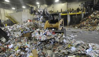 Recyclable materials is loaded to one side of the room at the SOCRRA center in Troy, Mich., on April 10, 2014.  Gov. Rick Snyder released a plan Monday, April 14, 2014,  to boost recycling of household solid waste in Michigan, which lags behind most other states despite once being a trendsetter with its beverage container deposit law. The initiative calls for doubling within two years the rate at which Michigan recycles cans, newspapers, bottles and other household refuse, presently estimated at 15 percent. Even then, it would remain below the national average, which the U.S. Environmental Protection Agency puts at 35 percent. (AP Photo/Detroit News, David Coates)  DETROIT FREE PRESS OUT; HUFFINGTON POST OUT