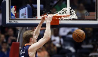Charlotte Bobcats center Cody Zeller (40) scores against the Atlanta Hawks in the first half of an NBA basketball game against the Atlanta Hawks in Atlanta Monday, April 14, 2014.  (AP Photo/John Bazemore)