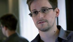 ** FILE ** A Sunday, June 9, 2013, file photo provided by The Guardian newspaper in London shows Edward Snowden, who worked as a contract employee at the U.S. National Security Agency. (AP Photo/The Guardian, File)