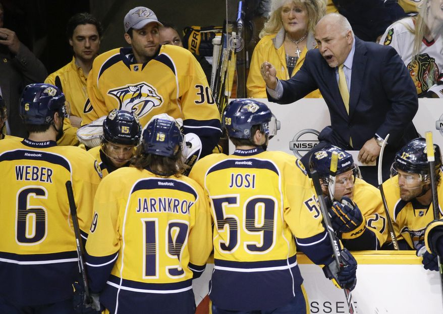 FILE - In this April 12, 2014, file photo, Nashville Predators head coach Barry Trotz, top right, talks with his players during a timeout in the first period of an NHL hockey game against the Chicago Blackhawks in Nashville, Tenn. The Predators announced Monday, April 14, that Trotz's contract will not be extended and the team will begin looking for a new head coach. (AP Photo/Mark Humphrey, File)