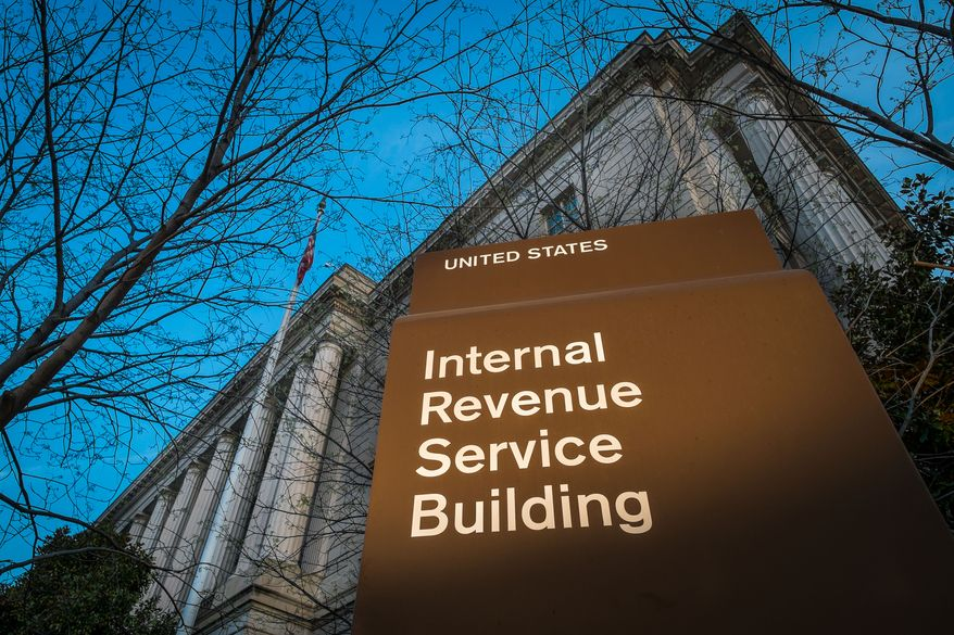 ** FILE ** This photo taken April 13, 2014, shows the headquarters of the Internal Revenue Service (IRS) in Washington at daybreak. (AP Photo/J. David Ake)