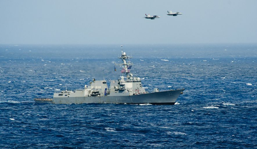 FILE: Fighter jets fly over U.S. destroyer in this Navy file photo.