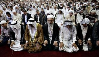 Worshipers attend joint Sunni-Shiite Friday prayers at Abdul-Qadir al-Gailani Mosque in Baghdad, Iraq on July 3, 2013. This year, leaders from the Shia and Sunni Muslim communities have stepped up international efforts to pursue peaceful relationships between their two communities. (Associated Press)