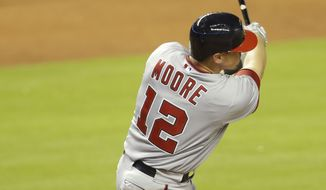 Washington Nationals' Tyler Moore hits a double during the ninth inning of MLB National League baseball game against the Miami Marlins, Monday, April 14, 2014, in Miami. The Nationals defeated the Marlins 9-2. (AP Photo/Lynne Sladky)