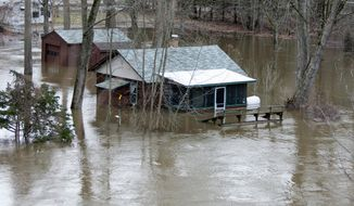Water floods a home by the Muskegon River in Grant, Mich., Monday, April 14, 2014. Several Michigan rivers are over their banks after three days of storms dropped as much of 5.5 inches of rain, forcing some flood plain residents from their homes. (AP Photo/The Grand Rapids Press, Cory Morse) ALL LOCAL TV OUT; LOCAL TV INTERNET OUT