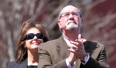 Boston Marathon bombing survivor John Odom stands with his wife Karen during a flag raising ceremony at Boston Medical Center on Monday, April 14, 2014.   (AP Photo/The Herald, Matt Stone)