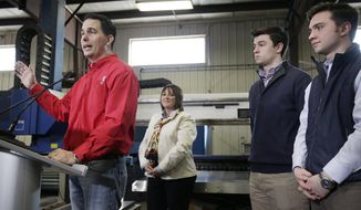 Surrounded by his family, Wisconsin Gov. Scott Walker speaks at a campaign rally at Dane Manufacturing in Dane, Wis., Tuesday, April 15, 2014. Walker officially launched his re-election campaign Tuesday with a series of rallies across Wisconsin.  (AP Photo/Wisconsin State Journal, M.P. King)
