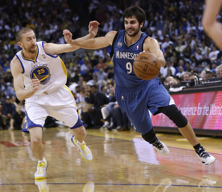Minnesota Timberwolves guard Ricky Rubio (9) dribbles next to Golden State Warriors' Steve Blake (25) during the first half of an NBA basketball game on Monday, April 14, 2014, in Oakland, Calif. (AP Photo/Marcio Jose Sanchez)