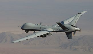 High hopes: The MQ-9 Reaper will be tested to determine whether flight time can be extended by housing fuel in its wings. (U.S. Air Force via Associated Press)