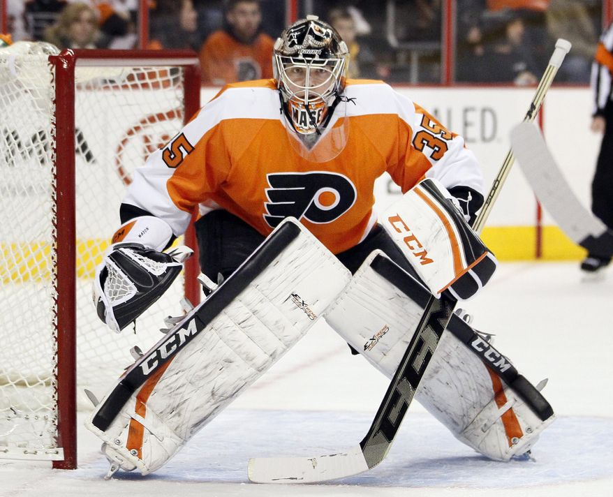 FILE - In this Jan. 18, 2014 file photo, Philadelphia Flyers' Steve Mason faces the action during the first period of an NHL hockey game against the New York Islanders, in Philadelphia. Mason practiced for only 15 minutes because of an upper-body injury and there's a chance the Flyers will start their playoff series against the Rangers without their No. 1 goalie. (AP Photo/Tom Mihalek, File)