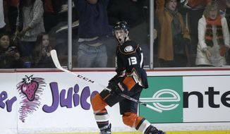 Anaheim Ducks' Nick Bonino celebrates his game-winning goal in overtime of an NHL hockey game against the Colorado Avalanche on Sunday, April 13, 2014, in Anaheim, Calif. The Ducks won 3-2 in overtime. (AP Photo/Jae C. Hong)