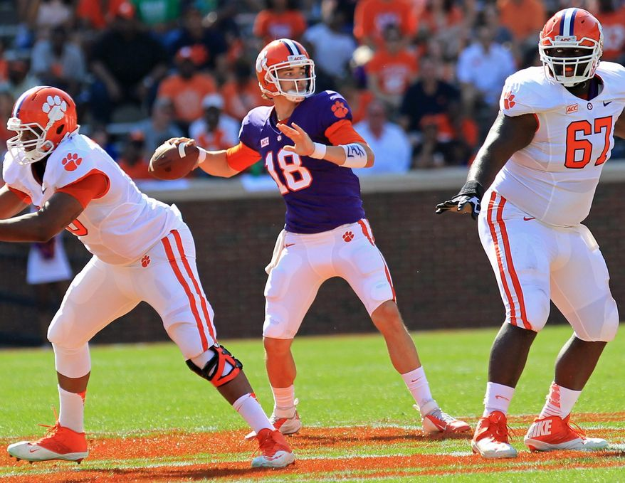Clemson quarterback Cole Stoudt, center, throws a pass during the NCAA college football team's spring game at Memorial Stadium in Clemson, S.C., on Saturday, April 12, 2014. (AP Photo/Anderson Independent-Mail, Mark Crammer) SENECA OUT  GREENVILLE NEWS OUT