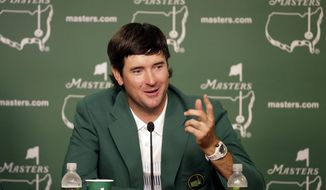 Bubba Watson, speaks during a press conference wearing his green jacket after winning the Masters golf tournament Sunday, April 13, 2014, in Augusta, Ga.  (AP Photo/Chris Carlson)