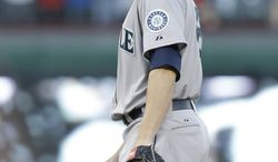 Seattle Mariners starting pitcher Blake Beavan looks down after he game up a solo home run to Texas Rangers Prince Fielder during the second inning of the MLB American League baseball game Tuesday, April 15, 2014, in Arlington, Texas. (AP Photo/LM Otero)