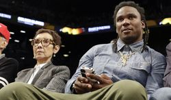 Former Tennessee Titans running back Chris Johnson watches the second half of an NBA basketball game between the New York Knicks and the Brooklyn Nets Tuesday, April 15, 2014, in New York. The The Knicks won 109-98. (AP Photo/Frank Franklin II)