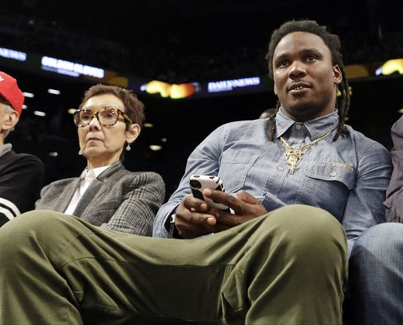 Former Tennessee Titans running back Chris Johnson watches the second half of an NBA basketball game between the New York Knicks and the Brooklyn Nets Tuesday, April 15, 2014, in New York.