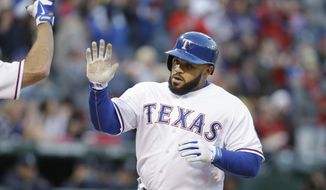 Texas Rangers Prince Fielder is congratulated after his solo home run during the second inning of the MLB American League baseball game against the Seattle Mariners Tuesday, April 15, 2014, in Arlington, Texas. (AP Photo/LM Otero)