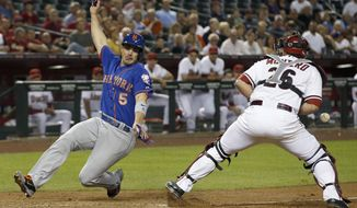 New York Mets' David Wright (5) starts his slide to home plate to score as Arizona Diamondbacks' Miguel Montero, right, drops the ball during the fifth inning of a baseball game on Monday, April 14, 2014, in Phoenix. (AP Photo/Ross D. Franklin)