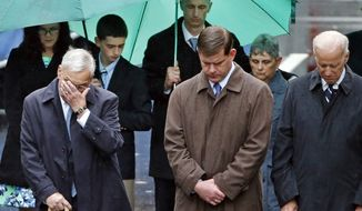 ** FILE ** Former Boston Mayor Thomas Menino, left, Boston Mayor Marty Walsh, center, and Vice President Joe Biden bow their heads along with the family of Boston Marathon bombing victim Martin Richard, behind, during a remembrance ceremony at the finish line on Boylston Street in Boston, Tuesday, April 15, 2014. (AP Photo/Elise Amendola)