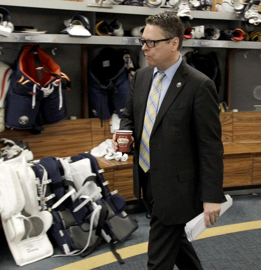 Buffalo Sabres general manager Tim Murray exits the Sabres locker room after players gathered for the last time on Monday, April 14, 2014, in Buffalo, N.Y. (AP Photo/Nick LoVerde)