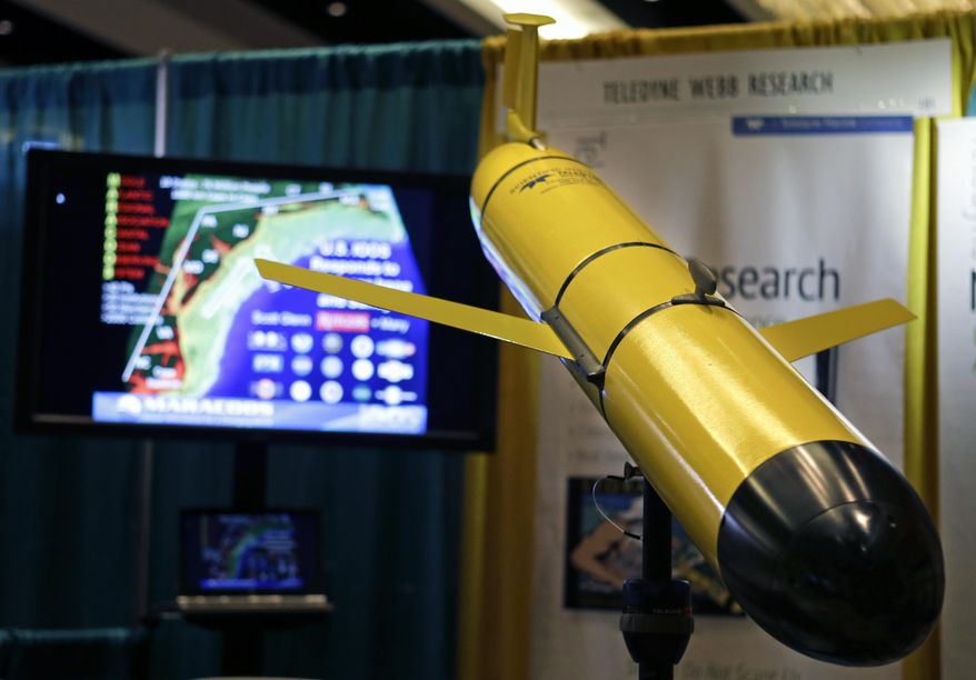 A Slocum G2 glider underwater vehicle made by Teledyne Webb Research is displayed at the 2014 National Hurricane Conference, Tuesday, April 15, 2014, in Orlando, Fla. The glider can be programmed to gather and transmit data of ocean features at a substantial savings compared to traditional surface ships. (AP Photo/John Raoux)