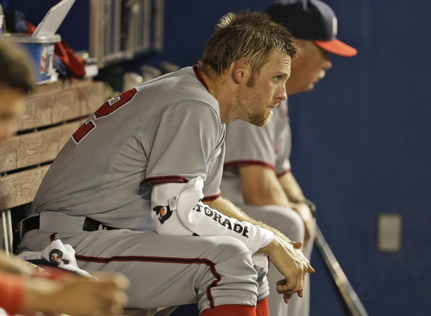 Washington Nationals starting pitcher Stephen Strasburg sits in the dugout during the fourth inning of MLB National League baseball game against the Miami Marlins, Tuesday, April 15, 2014, in Miami. (AP Photo/Lynne Sladky)