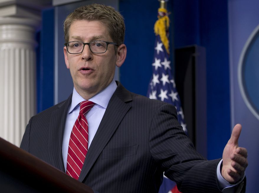 White House press secretary Jay Carney gestures as he speaks during the daily news briefing at the White House in Washington, Tuesday, April 15, 2014. Carney discussed the Ukraine and that the media will not have access to President Barack Obama's meeting with senior advisors where he will also observe a moment of silence to mark the one-year anniversary of the Boston Marathon bombing, and other topics. (AP Photo/Carolyn Kaster)